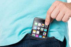 Man Removing Apple iPhone 6 From Pocket Stock Image