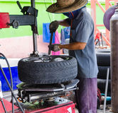 The man removing car tire Royalty Free Stock Photo