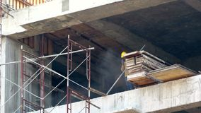 Man Removing Concrete Forms From The Ceiling stock video footage
