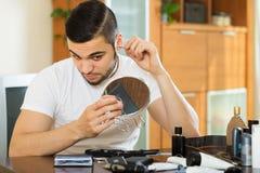 Man removing ear hair Stock Photos