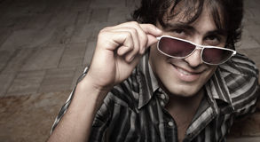 Man removing his shades Stock Image