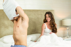 Man removing his vest in front of woman Stock Photography
