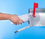 Man removing a newspaper from his mailbox Royalty Free Stock Photos