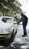 Man removing snow. From his car stock images