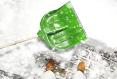 Man removing snow on the backyard with the shovel during snowfall Stock Images