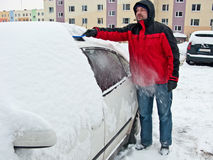 Man removing snow from car Royalty Free Stock Image