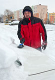 Man removing snow from car Stock Images