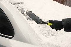Man removing snow from car Stock Photo