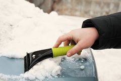 Man removing snow from car Stock Photos