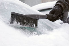 Man removing snow and ice from window Royalty Free Stock Image