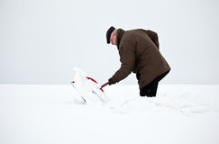 Man removing snow with a shovel Royalty Free Stock Image