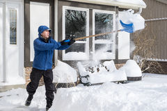 Man Removing Snow with a Shovel #4 Royalty Free Stock Image