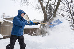 Man Removing Snow with a Shovel #5 Stock Image