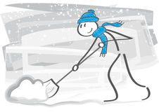 Man Removing Snow with a Shovel. Stick figure with snow shovel cleans sidewalks in winter Stock Photo