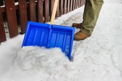 Man removing snow from the sidewalk Royalty Free Stock Image