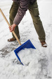 Man removing snow from the sidewalk Stock Photo