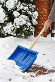 Man removing snow from the sidewalk after snowstorm Royalty Free Stock Photography