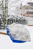 Man removing snow from the sidewalk after snowstorm Royalty Free Stock Photo