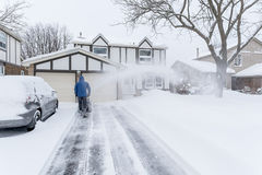 Man Removing Snow with a Snow Blower #4 Stock Photos