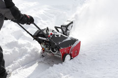 Man removing snow after storm with a snowblower. Man removing snow with a snowblower after a blizzard Royalty Free Stock Photo