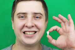 A man after removing a wisdom tooth. The operation to remove the eighth teeth stock photography