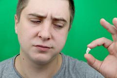 A man after removing a wisdom tooth. The operation to remove the eighth teeth stock image