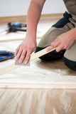 Man renovating floor in new flat Stock Photos