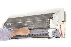 Man repair air conditioner. Specialist man repair air conditioner Royalty Free Stock Image