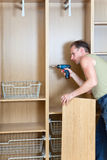 The man repair and furniture assemblage Stock Photo