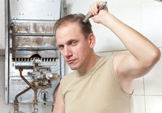 The man repair of a gas water heater Stock Images