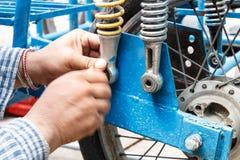 Man repair motorcycle Royalty Free Stock Images
