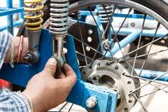 Man repair motorcycle Stock Photos