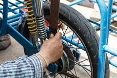 Man repair motorcycle Stock Image