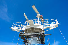 A man repair radar. Radar antenna of commercial vessel repairing by one man climb on top of antenna and below had erect scaffolding for protection stock photography