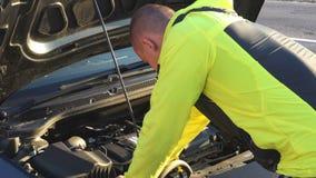 Man repair under the hood of car.  stock video