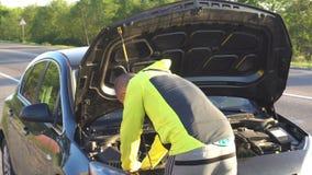 Man repair under the hood of car.  stock video footage