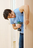 Man repairing. The door handle furniture Stock Images