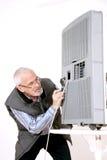 Man repairing air conditioning Royalty Free Stock Image
