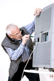 Man repairing air conditioning Stock Images
