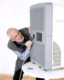 Man repairing air conditioning Royalty Free Stock Photography