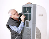 Man repairing air conditioning Royalty Free Stock Images