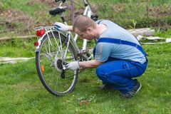 Man repairing a bicycle royalty free stock image