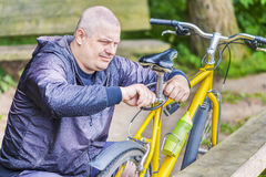 Man repairing bicycle Stock Image