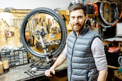 Man repairing a bicycle in the workshop stock image