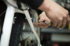 Man repairing a bike Stock Photos