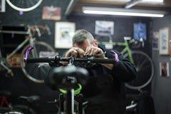 Man repairing a bike Royalty Free Stock Photo