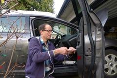 Man Repairing the Broken Car Door Stock Images
