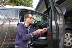 Man Repairing the Broken Car Door Royalty Free Stock Image