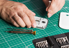 Man repairing broken smartphone, close up photo.  stock images