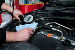 A man repairing a car engine Royalty Free Stock Images